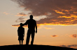 stock-photo-18254245-father-and-child-silhouette